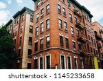 tall vintage building with... | Shutterstock . vector #1145233658