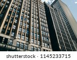 tall modern constructed... | Shutterstock . vector #1145233715