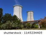 cooling towers of an alumina... | Shutterstock . vector #1145234405