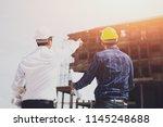 construction engineers... | Shutterstock . vector #1145248688