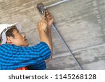 construction worker and... | Shutterstock . vector #1145268128