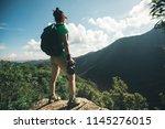 successful woman hiker taking... | Shutterstock . vector #1145276015