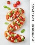 bruschetta with tomatoes ... | Shutterstock . vector #1145319392