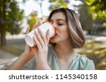 young woman is drinking... | Shutterstock . vector #1145340158
