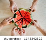 red watermelon is cut in equal... | Shutterstock . vector #1145342822