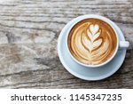 a beautiful cup of cappuccino... | Shutterstock . vector #1145347235