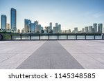 empty square with city skyline... | Shutterstock . vector #1145348585