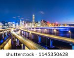busy traffic road with city... | Shutterstock . vector #1145350628