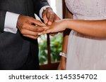 a close up of hands of a... | Shutterstock . vector #1145354702