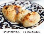 oven baked samosa stuffed bun ...   Shutterstock . vector #1145358338