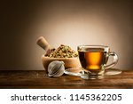 glass cup of tea with infuser... | Shutterstock . vector #1145362205