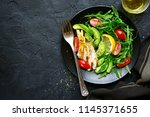 vegetable salad with roasted... | Shutterstock . vector #1145371655