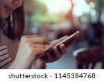 woman using smartphone on cafe  ... | Shutterstock . vector #1145384768