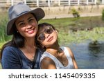 two asian girls  happy  posing... | Shutterstock . vector #1145409335