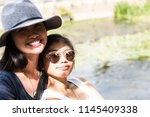 two asian girls  happy  posing... | Shutterstock . vector #1145409338