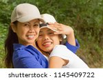 mother and daughter happily... | Shutterstock . vector #1145409722