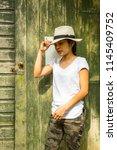 girl posing with genuine smile  ... | Shutterstock . vector #1145409752