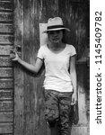 black and white  girl posing... | Shutterstock . vector #1145409782