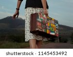 Woman With Vintage Travel...