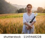 asian woman with ukulele in... | Shutterstock . vector #1145468228