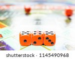 cubes lie on the board game... | Shutterstock . vector #1145490968