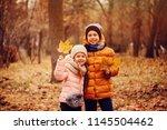 autumn portrait of happy kids... | Shutterstock . vector #1145504462
