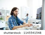 serious concentrated hipster... | Shutterstock . vector #1145541548