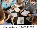 high angle crop shot of team of ... | Shutterstock . vector #1145541578