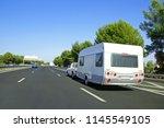 caravan towed on highway during ... | Shutterstock . vector #1145549105