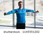 attractive man exercising with...   Shutterstock . vector #1145551202