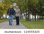 older casual couple walking in... | Shutterstock . vector #114555325