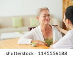 smiling aged asian woman...   Shutterstock . vector #1145556188