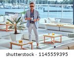 fashionable successful man with ...   Shutterstock . vector #1145559395