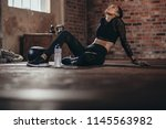 tired woman having rest after... | Shutterstock . vector #1145563982