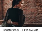 rear view of beautiful woman in ... | Shutterstock . vector #1145563985