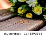 wedding rings lie and beautiful ... | Shutterstock . vector #1145593985