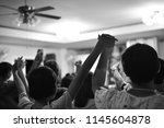 hold hands to worship god  | Shutterstock . vector #1145604878