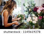 florist makes a bouquet. | Shutterstock . vector #1145619278