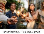 guests burning sparklers and... | Shutterstock . vector #1145631935