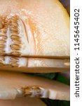 sliced into pieces ripe juicy... | Shutterstock . vector #1145645402