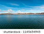 snow above the city of puno in... | Shutterstock . vector #1145654945