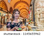 beautiful woman looks... | Shutterstock . vector #1145655962