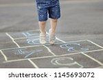 closeup of little boy's legs... | Shutterstock . vector #1145693072