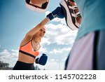 low angle of slim woman having... | Shutterstock . vector #1145702228
