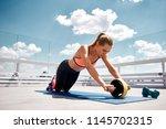 slim lady is training abdominal ...   Shutterstock . vector #1145702315
