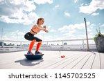 athlete girl is enjoying work...   Shutterstock . vector #1145702525