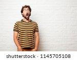 young dumb man looking... | Shutterstock . vector #1145705108