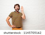 young dumb man paying attention ... | Shutterstock . vector #1145705162