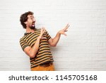 young dumb man looking scared ... | Shutterstock . vector #1145705168