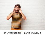 young dumb man shouting loud... | Shutterstock . vector #1145706875
